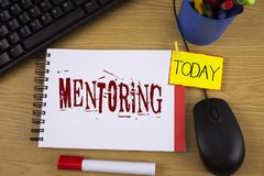 Word writing text Mentoring. Business concept for To give advice or support to a younger less experienced person written on Noteoa. Word writing text Mentoring Royalty Free Stock Photography