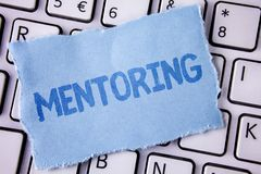 Word writing text Mentoring. Business concept for To give advice or support to a younger less experienced person written on Tear S. Word writing text Mentoring Stock Photo