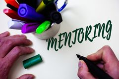 Word writing text Mentoring. Business concept for To give advice or support to a younger less experienced person Artist study libr. Ary colourful pen bunch stock photography