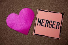 Word writing text Merger. Business concept for Combination of two things or companies Fusion Coalition Unification Love heart stic. Ky small papers remember royalty free stock image