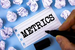 Word writing text Metrics. Business concept for Method of measuring something Study poetic meters Set of numbers written by Man on. Word writing text Metrics Royalty Free Stock Photo