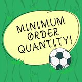 Word writing text Minimum Order Quantity. Business concept for lowest quantity of a product a supplier can sell Soccer. Ball on the Grass and Blank Outlined royalty free illustration