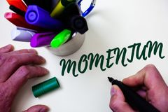 Word writing text Momentum. Business concept for Quantity motion in moving body Product of mass and velocity Artist study library. Colourful pen bunch stock photography