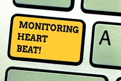 Word writing text Monitoring Heart Beat. Business concept for Measure or record the heart rate in real time Keyboard key. Intention to create computer message royalty free stock photography