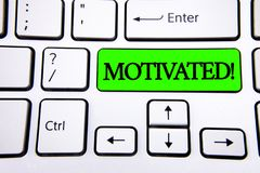 Word writing text Motivated Motivational Call. Business concept for Willing to do something Inspired Confident written on Green Ke. Word writing text Motivated Royalty Free Stock Photos