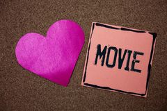 Word writing text Movie. Business concept for Cinema or television film Motion picture Video displayed on screen Love heart sticky. Small papers remember rough Stock Photography