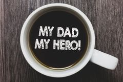 Word writing text My Dad My Hero. Business concept for Admiration for your father love feelings emotions compliment Black coffee w. Ith coffee mug floating texts stock photo