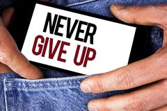 Word writing text Never Give Up. Business concept for Be persistent motivate yourself succeed never look back written on Mobile ph. Word writing text Never Give Royalty Free Stock Images