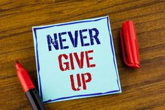 Word writing text Never Give Up. Business concept for Be persistent motivate yourself succeed never look back written on Sticky no. Word writing text Never Give Stock Photo