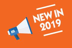 Word writing text New In 2019. Business concept for list of fresh things got introduced this year or the next Megaphone loudspeake. R orange background important vector illustration