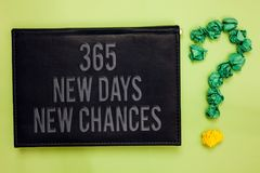 Word writing text 365 New Days New Chances. Business concept for Starting another year Calendar Opportunities Green back black pla. Nk with text green paper lob royalty free stock photos