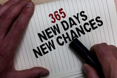 Word writing text 365 New Days New Chances. Business concept for Starting another year Calendar Opportunities Man's hand grasp bl. Ack marker with some black and stock photos