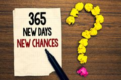 Word writing text 365 New Days New Chances. Business concept for Starting another year Calendar Opportunities Written torn page to. Uch black pen yellow paper royalty free stock images