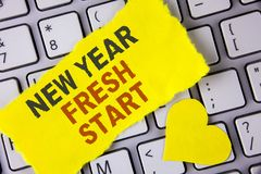 Word writing text New Year Fresh Start. Business concept for Time to follow resolutions reach out dream job written on tear Sticky. Word writing text New Year royalty free stock image