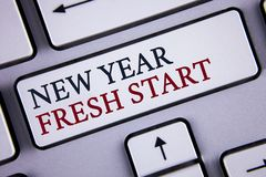 Word writing text New Year Fresh Start. Business concept for Time to follow resolutions reach out dream job written on White Keybo. Word writing text New Year Stock Photos