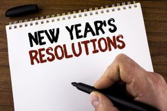 Word writing text New Year'S Resolutions. Business concept for Goals Objectives Targets Decisions for next 365 days written by Ma. N Notepad holding Marker the Royalty Free Stock Image