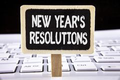 Word writing text New Year'S Resolutions. Business concept for Goals Objectives Targets Decisions for next 365 days written on Wo. Word writing text New Year'S Royalty Free Stock Images