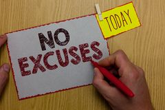 Word writing text No Excuses. Business concept for telling someone not to tell reasons for certain problem Man holding marker pape. R clothespin reminder express royalty free stock images