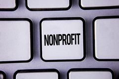 Word writing text Nonprofit. Business concept for Activities that do not generate revenues to the executor written on White Keyboa. Word writing text Nonprofit Royalty Free Stock Images