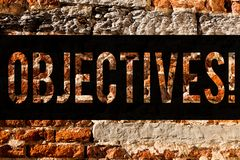 Word writing text Objectives. Business concept for Goals planned to be achieved Desired targets Brick Wall art like Graffiti. Motivational call written on the royalty free stock photography