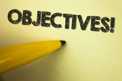 Word writing text Objectives Motivational Call. Business concept for Goals planned to be achieved Desired targets written on plain. Word writing text Objectives royalty free stock photos