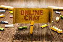 Word writing text Online Chat. Business concept for talking with friend or someone through internet and PC phone Clothespin holdin. G old piece fabric several royalty free stock photo
