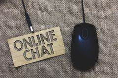 Word writing text Online Chat. Business concept for talking with friend or someone through internet and PC phone Paperboard comput. Er mouse jute background royalty free stock photography