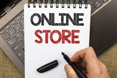 Word writing text Online Store. Business concept for Internet related business Website where you can buy in the net written by Man. Holding Pen Notebook Book Stock Image