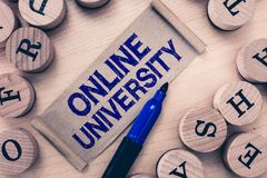 Word writing text Online University. Business concept for Distance Learning Courses are taken over the internet.  stock photo