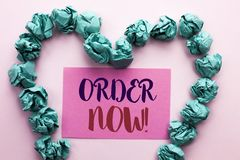 Word writing text Order Now. Business concept for Buy Purchase Order Deal Sale Promotion Shop Product Register written on Pink Sti. Word writing text Order Now Royalty Free Stock Photos
