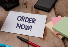 Word writing text Order Now. Business concept for confirmed request by one party to another to buy sell Top view wooden. Word writing text Order Now. Business royalty free stock photography