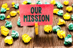 Word writing text Our Mission. Business concept for tasks or schedule we need to made them right in order success Clothespin holdi. Ng pink note paper crumpled royalty free stock images