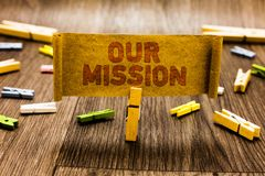 Word writing text Our Mission. Business concept for tasks or schedule we need to made them right in order success Clothespin holdi. Ng old piece fabric several stock photos
