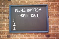 Word writing text People Buy From People They Trust. Business concept for Building trust and customer satisfaction. royalty free stock photos
