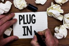 Word writing text Plug In. Business concept for putting device into electricity to turn it on Power it Connecting Man holding mark royalty free stock image