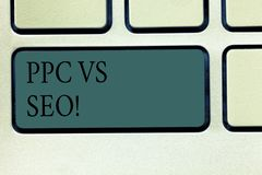 Word writing text Ppc Vs Seo. Business concept for Pay per click against Search Engine Optimization strategies Keyboard. Key Intention to create computer royalty free stock photo