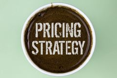 Word writing text Pricing Strategy. Business concept for Marketing sales strategies profit promotion campaign written on Coffee in. Word writing text Pricing Royalty Free Stock Photography