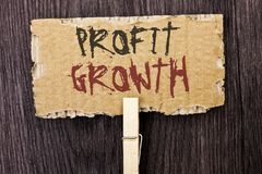 Word writing text Profit Growth. Business concept for Financial. Success Increased Revenues Evolution Development written Cardboard Piece Holding With Clip the Royalty Free Stock Photography