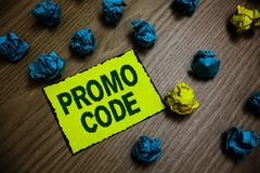 Word writing text Promo Code. Business concept for digital numbers that give you good discount on certain product Yellow piece pap. Er reminder lots crumpled royalty free stock image