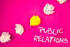 Word writing text Public Relations. Business concept for Communication Media People Information Publicity Social Words pink backgr. Ound crumbled paper notes royalty free stock image