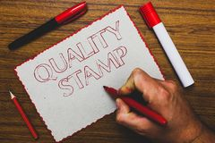 Word writing text Quality Stamp. Business concept for Seal of Approval Good Impression Qualified Passed Inspection Man hand holdin. G marker notebook paper royalty free stock photography