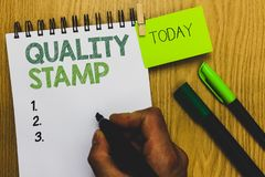 Word writing text Quality Stamp. Business concept for Seal of Approval Good Impression Qualified Passed Inspection Man holding mar. Ker notebook clothespin royalty free stock photo