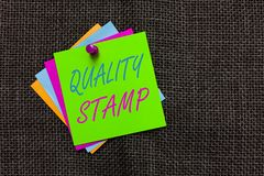 Word writing text Quality Stamp. Business concept for Seal of Approval Good Impression Qualified Passed Inspection Paper notes Imp. Ortant reminders Communicate stock photography
