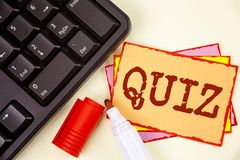 Word writing text Quiz. Business concept for Short Tests Evaluation Examination to quantify your knowledge written on Sticky Note. Word writing text Quiz Royalty Free Stock Image