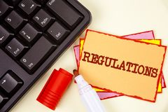 Word writing text Regulations. Business concept for Rules Laws Corporate Standards Policies Security Statements written on Sticky. Word writing text Regulations Royalty Free Stock Photo