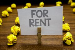 Word writing text For Rent. Business concept for when you make property available for purchasing temporarily Clothespin hold holdi stock image