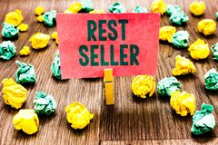 Word writing text Rest Seller. Business concept for one feature or the perceived benefit good which makes it unique Clothespin hol. Ding pink note paper crumpled royalty free stock photos