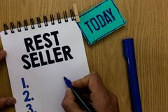 Word writing text Rest Seller. Business concept for one feature or the perceived benefit good which makes it unique Man holding ma. Rker notebook clothespin royalty free stock photo