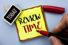 Word writing text Review Time. Business concept for Evaluating Survey Reviewing Analysis Checkup Inspection Revision written by Ma. N Holding Marker Sticky Note Royalty Free Stock Photos