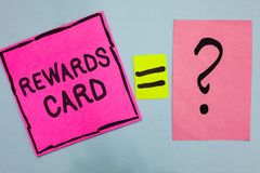 Word writing text Rewards Card. Business concept for Help earn cash points miles from everyday purchase Incentives Pink paper note stock image